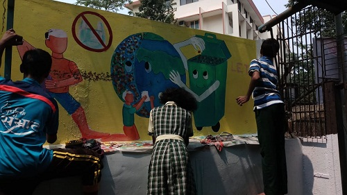 Students doing wall painting
